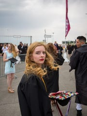 NMSU graduate in Theatre Arts and Psychology Kia Ashley looks at the camera before entering the Pan American Center for commencement ceremonies, May 14, 2016.