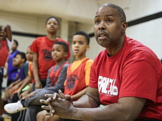 At right, Anthony Humbles coaches a Police Athletic League basketball game at the JTV Hill Center in the Martindale-Brightwood neighborhood in Indianapolis, Thursday, Feb. 8, 2018. Humbles volunteers several hours a week coaching 7- to 10-year-olds. Humbles is thankful for his ability to coach again, after undergoing a heart transplant on Valentine's Day in 2017.