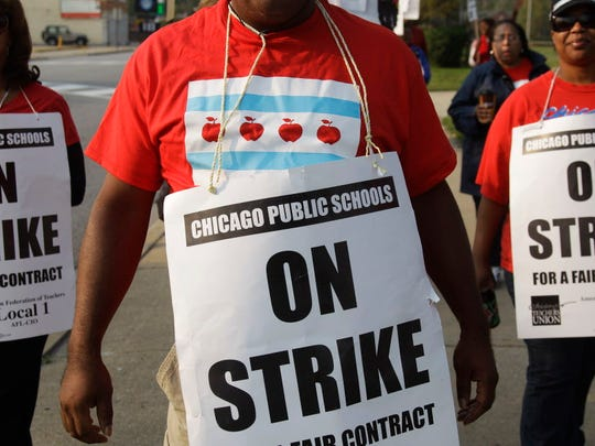 In this Sept. 17, 2016, file photo, teachers picket