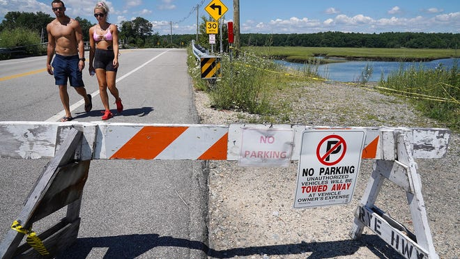 The bridge along Route 1A at Rye Harbor is barricaded with posted signs to keep motorists from parking and clusters of people from bridge jumping. Beach rules say no dropping off, all along Route 1A.