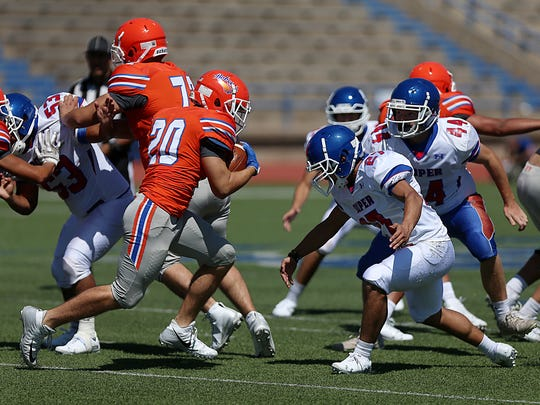Central's Bobby Pena (20) comes up against Abilene Cooper's Joseph Flores (#27) during a game of scrimmage at San Angelo Stadium Friday, August 24, 2018.
