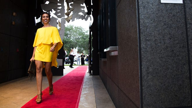 Sarah LaMont, a personal shopper for WhyStyle, struts down the red carpet during the Naples International Film Festival opening night gala on Thursday, October 27, 2016 at Artis-Naples in North Naples.  Guests enjoyed drinks and appetizers before watching the opening film, Alive and Kicking.
