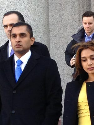 Mathew Martoma, left, leaves federal court in New York City with his wife, Rosemary after his 2014 conviction in an insider-trading case.