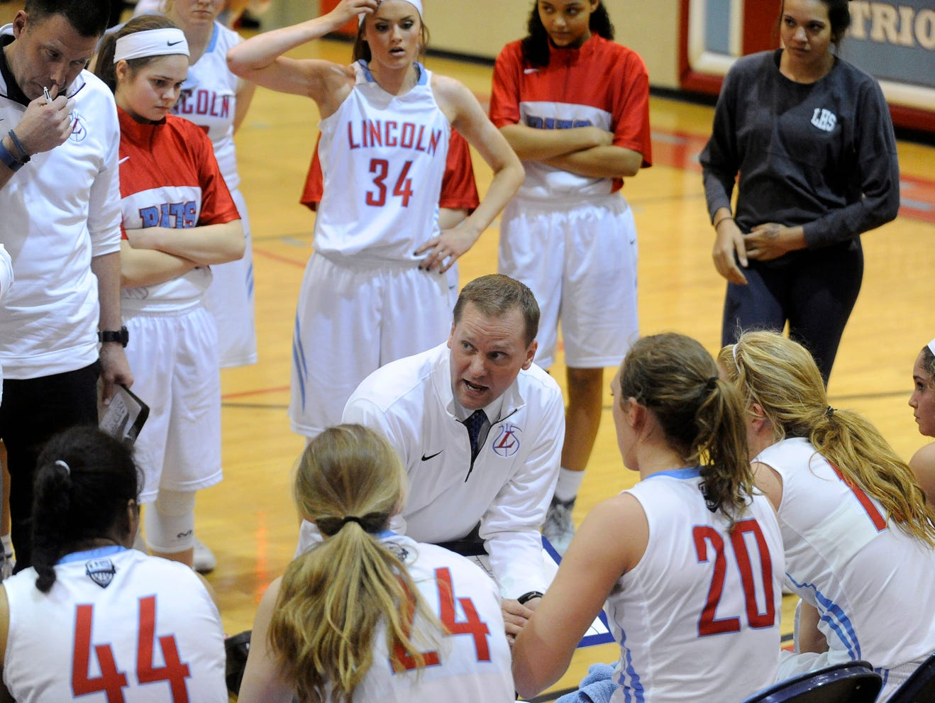 Lincoln's head coach Matt Daly talks with his team during a timeout against Roosevelt during girls basketball action at Lincoln High School in Sioux Falls, S.D., Thursday, Feb. 18, 2016.