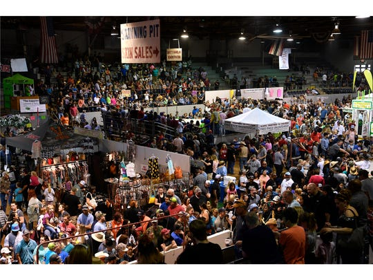 Crowds pack the Nolan County Coliseum for the 60th annual World's Largest Rattlesnake Roundup in Sweetwater.