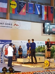 Jacinta Sumagaysay receives her silver medal after her record-breaking performance at the Oceania Weightlifting Championships June 29 in New Caledonia.