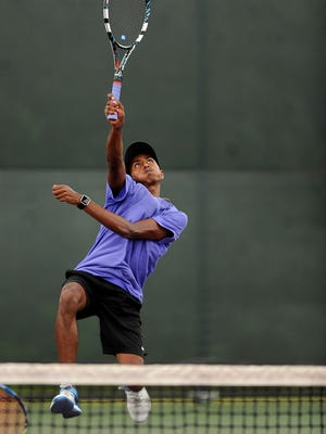 Wylie's Nikhil Kalla returns a ball at the net during the Class 4A boys doubles quarterfinal with partner Davyn Williford against Lampasas at the UIL State Tennis Championships on Thursday, May 18, 2017, at the George P. Mitchell Tennis Center in College Station.