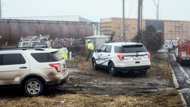 Police and railroad personnel are at the scene of a car-train accident near the intersection of Waverly and Lansing Roads early Sunday, January 22, 2017. An elderly woman's car was stuck on the tracks but she was able to get out of the car before it was struck by the train.
