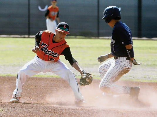Rudy Gutierrez—El Paso Times El Paso High's Brendon Johnston, left, catches the throw at second too late as Del Valle's Matt Martinez arrived there first during the second game between the two teams Saturday.