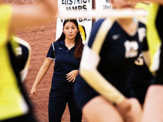 Fabens volleyball coach Jenny Nolasco watches her team as they play Loretto who is coached by her former UTEP teammate Amy Sanders.