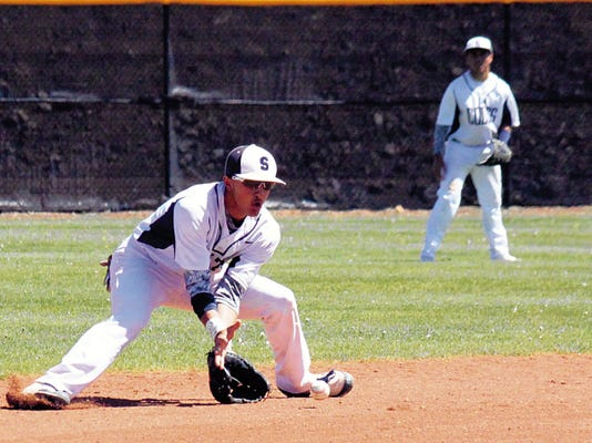 Danny Udero/Sun-News   Silver shortstop Zach Jasso makes this routine play during action against Taos Saturday at the Ben Altamirano Sports Complex.
