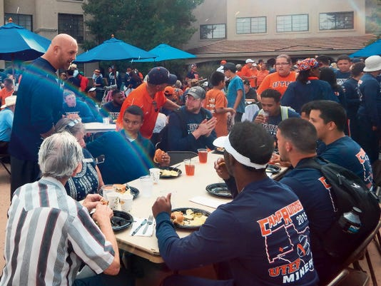 UTEP head football coach Sean Kugler makes the rounds during the barbecue.