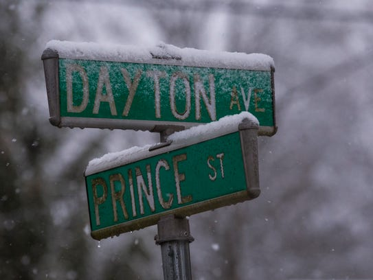 Light snow gently coats street signs in Toms River