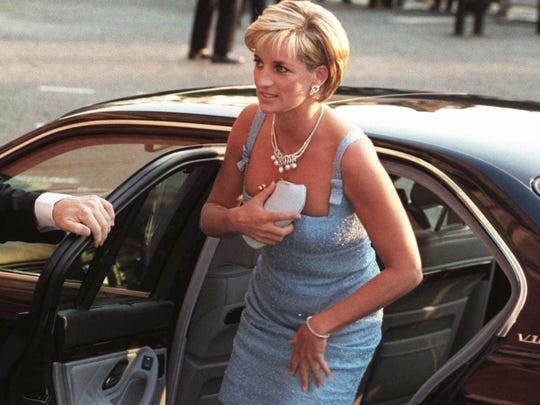 "Diana wore more pared-down, lower cut and shorter styles in the mid-1990s, like the one in 1997 at a performance of ""Swan Lake"" in England's Royal Albert Hall."