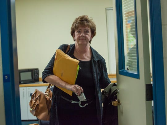 Elizabeth Fitzgerald, chairwoman of the South Burlington School Board, leaves an executive session Wednesday night at Orchard Elementary School.