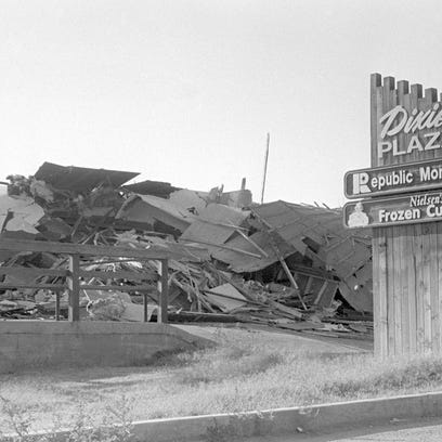 The Dixie Plaza shopping center was demolished in September of 1992 after a fire gutted the building as can be seen in the then image taken from the Spectrum & Daily News archives. The bench and cement foundation that had been a part of Nielsen's Frozen Custard since the store first moved into the shopping center in 1985 - Steve Nielsen, the founder and owner of Nielsen's Frozen Custard, wrote his initials in the cement of the front porch and they can still be seen in the sidewalk today - was reused when the building was rebuilt. In the background of the then image the Flood Street Movie Theater can be seen but the new structure covers that view in the now image taken by Spectrum and Dily News photographer Jud Burkett.