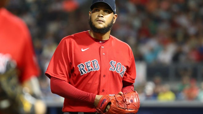 """Red Sox pitcher Eduardo Rodriguez, seen here during spring training before the pandemic shut down baseball, said the symptoms made him """"feel like I was 100 years old."""""""