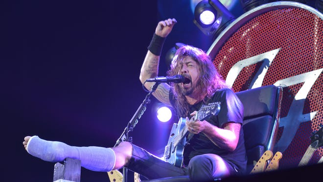 Dave Grohl, lead singer of  rock band The Foo Fighters, performs during the band's 20th anniversary concert at RFK Stadium in Washington, D.C. on July 4, 2015.