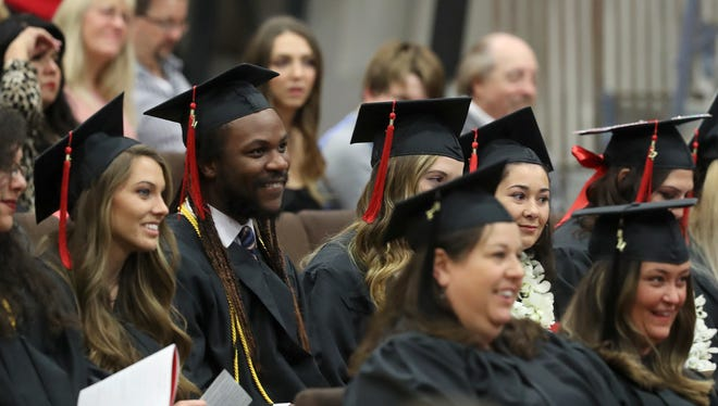 Simpson University students who graduated Saturday listen during the afternoon commencement ceremony inside the James M. Grant Student Life Center. More than 125 students graduated, including those in a morning ceremony for the School of Adult Studies' ASPIRE degree-completion program.