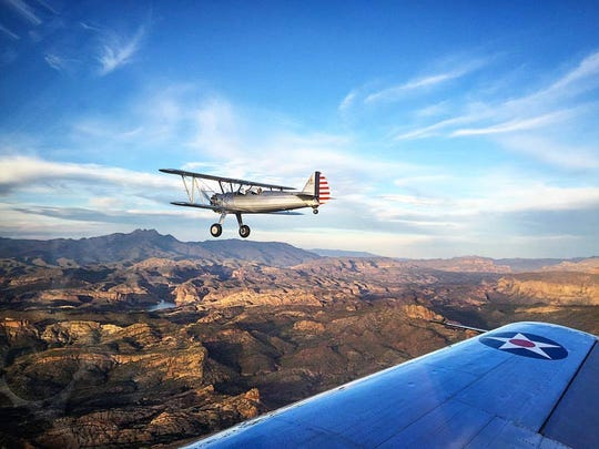 Jesse Goodwin flying a Stearman Biplane over Canyon Lake.