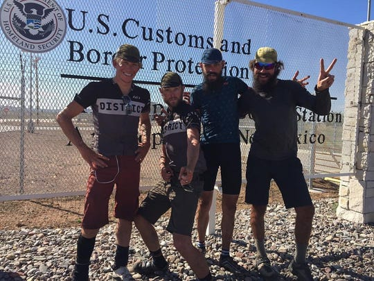Posing at the Tour Divide finish line at the Mexican border are, from left: Seth Woods, Bobby Wintle, David Markman and Jay Barre. The four set a similar pace and wound up riding together.