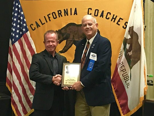 Rancho Mirage girls' tennis coach Owen McIntosh, left, accepts his 2017 High School Girls' Tennis Coach of the Year award for the state of California.