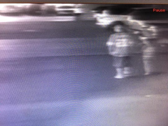 Although the image is blurred, police hope this security camera footage will help identify a man who carjacked a vehicle Thursday at the Nugget in Sparks. The child with him was also taken into the car, according to the victim.
