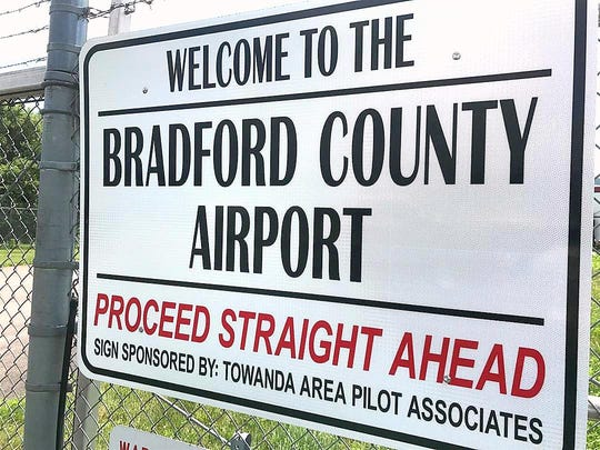 A sign greets visitors to the Bradford County Airport. A plane crashed near the field July 19.