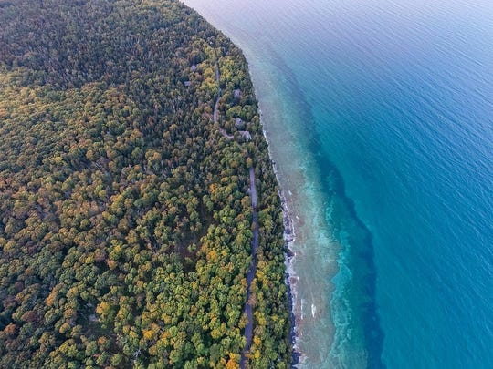 Cave Point County Park in Door County features cliffs overlooking clear blue water.