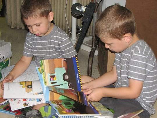 Children are among those who enjoy perusing the books