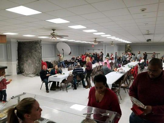 Volunteers prepare breakfast for Sunday's Breakfast With Santa Event.