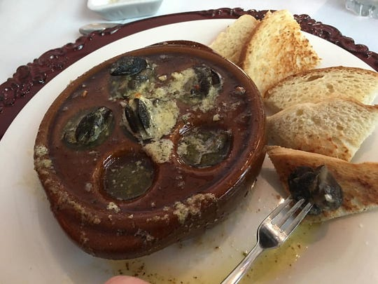 The escargot at Aragosta rivals that of the ones available