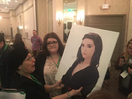 Tina Grimmie begins to cry as she is given a painting of her late daughter Christina Grimmie by artist Bella Paleologos (right) prior to the East Coast event for the Christina Grimmie Foundation at the Mansion in Voorhees last March. The foundation was started in 2017 in honor of the late singer/songwriter. Tina Grimmie passed away in September after a battle with cancer.