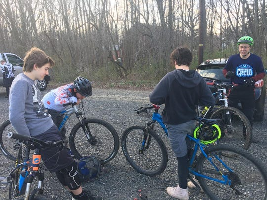 Camden County MTB Crew team head coach Robert Garrett (right) gives some of his team members instructions before a recent practice in Cherry Hill.