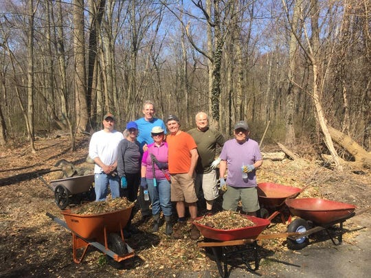 Community volunteers assist with a project run by the Borough's Woodlands Committee.