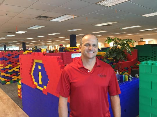Chris Miles, CEO of Miles Technologies, stands inside of the company's new digs in Lumberton where the desks, cubicles and more are made of giant Lego-type pieces called jumbo blocks.