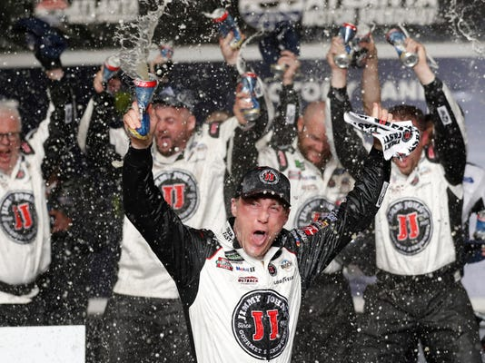 Kevin Harvick (4) reacts after winning the NASCAR Cup Series auto race at Atlanta Motor Speedway in Hampton, Ga., on Sunday, Feb. 25, 2018. (AP Photo/John Bazemore)