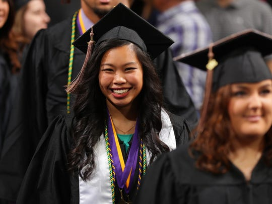 Students process into the McLeod Center for the University of Northern Iowa Spring Commencement.