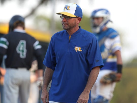 Rickards baseball coach Brian Kelley talks to his team as they take on South Walton during their Region 1-5A semifinal game at the Rickards Sports Complex on Tuesday, May 8, 2018.