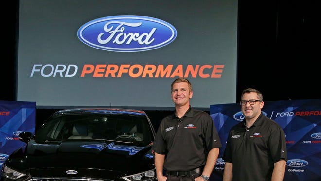 Team owner Tony Stewart, right, and driver Clint Bowyer Wednesday at the Ford Performance Technical Center.