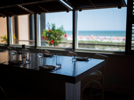 The dining area overlooks the ocean inside Olón in