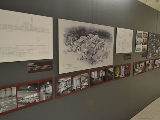 "Original drawings of residential, commercial and industrial buildings, including De Pere's St. Norbert Abbey, center, are featured in the new ""Building our Community: 100+ Years of Architecture and Design in Brown County"" exhibit at Neville Public Museum in Green Bay."