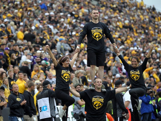 Iowa alumni perform for fans during the Hawkeyes' game