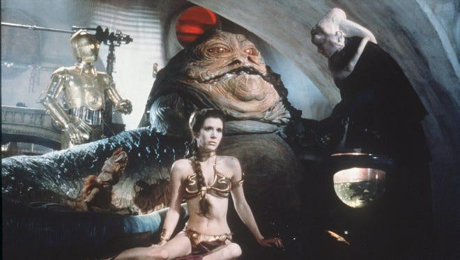 "Princess Leia (Carrie Fisher) plays captive to Jabba the Hut in ""Return of the Jedi SPecial Edition."""