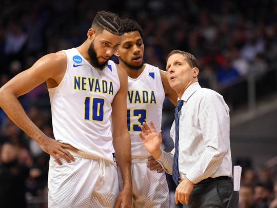 Nevada head coach Eric Musselman talks to forward Caleb Martin (10) and guard Hallice Cooke (13) during the second half against Loyola in the NCAA Tournament regional semifinals.