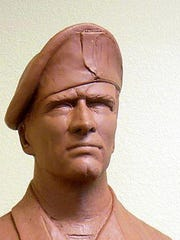 This is the clay version of a bust Ron Moore is sculpting to honor veterans of America's current war. He also is at work on a bust honoring women veterans.