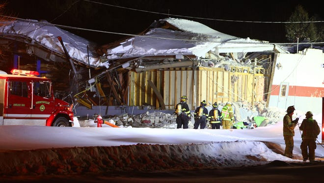 Firefighters work the scene of a collapse on East High Street in Shortsville Saturday evening.