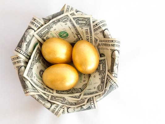 Top view of three golden eggs in a dollar nest