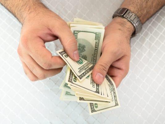 Man counting dollar notes