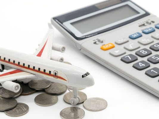 Calculator and toy plane on white background